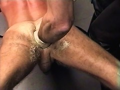Caged male slave has his ass fisted deep