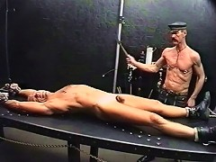 CBT on a gay slave by his two old masters