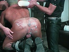 A huge candle pours hot wax on his body