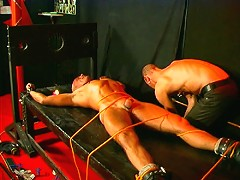 Tied up slaves cock gets the hot wax treatment