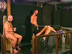 Slaves are caned and waxed one at a time